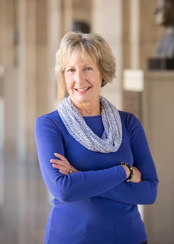 business woman wearing blue blouse.